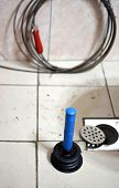 pic of plunger  - Plunger some wires and a clogged drain - JPG