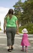 stock photo of obesity children  - Obese mother and child walking on a forest path on a beautiful summer day - JPG