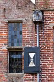 Detail Of A Brick Wall With Window And Drainpipe poster