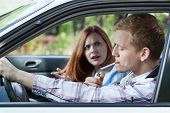 stock photo of smoking woman  - Woman mad at man for smoking cigarette in car - JPG