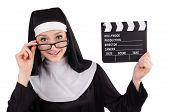 stock photo of nun  - Nun with movie board isolated on white - JPG