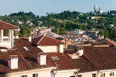 stock photo of vicenza  - View of typical roofs of some houses in Vicenza with Mount Berico in the background - JPG