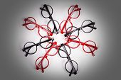 image of bifocals  - Stack of red and black glasses with vignette - JPG