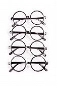 stock photo of bifocals  - Stack of black glasses isolated on white - JPG