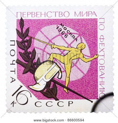 Stamp printed in the USSR Russia shows a fencer, mask and rapi