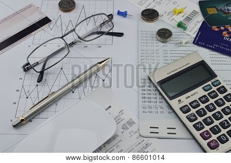 Calculator, Pen, Account Book, Glasses And Coin On Paper Chart, Saving Background