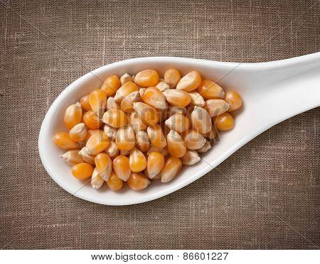 Yellow Corn Kernels In White Porcelain Spoon / High-res Photo Of Grain In White Porcelain Spoon On B