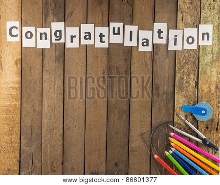 Word Congratulation  And Stationery Set  On Wooden