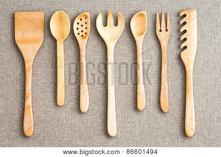 Row Of Assorted Wooden Kitchen Utensils