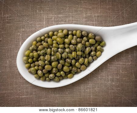 Mung Beans In A Wooden Spoon / High-res Photo Of Grain In White Porcelain Spoon On Burlap Sackcloth