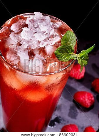 Cold red drink  with berry and mint leaf. Top view. Close up.