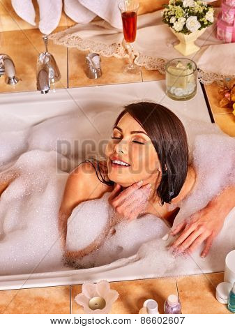 Woman relaxing at home luxury bath. Top view.