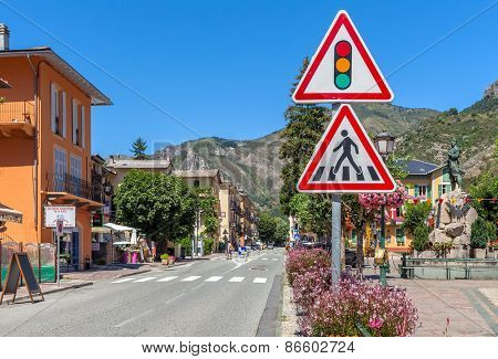 TENDE, FRANCE - AUGUST 12, 2014: Traffic signs on road in Tende - small town in French Alps located on old route of salt trade, popular with tourists and known for its cheese, honey and jams.