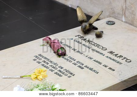 Sanctuary of Fatima, Portugal, March 07, 2015 - Tomb of Francisco Marto, one of the three young shepherds that witnessed the apparition and miracle of Our Lady. Basilica of Our Lady of the Rosary