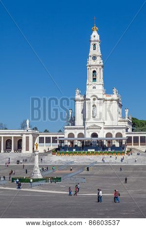 Sanctuary of Fatima, Portugal, March 07, 2015 - Basilica of Our Lady of the Rosary, the Sacred Heart of Jesus Monument and colonnade. One of the most important pilgrimage locations for the Catholics