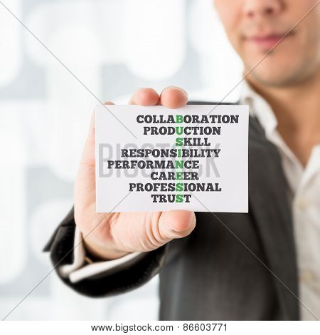Man Holding Card With Business And Related Words