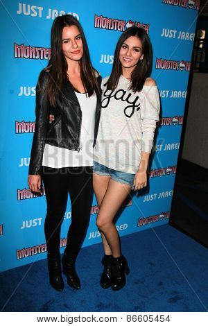 LOS ANGELES - MAR 26:  Madison Reed, Victoria Justice at the Just Jared's Throwback Thursday Party at the Moonlight Rollerway on March 26, 2015 in Glendale, CA