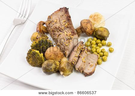 Cut In Slices Roast Beef With Grilled Mushrooms, Broccoli And Brussels Sprouts.