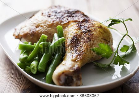 roast chicken leg with green beans