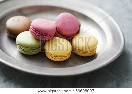 vintage dish with colourful macaroons