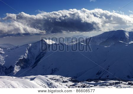 Winter Mountains At Evening And Sunlight Clouds
