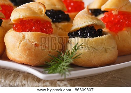 Fresh Profiteroles With Red And Black Caviar Macro. Horizontal