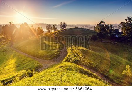 Green hills glowing by warm sunlight at twilight. Dramatic scene. Colorful sky. Carpathian, Ukraine, Europe. Beauty world. Retro and vintage style, soft filter. Instagram toning effect.