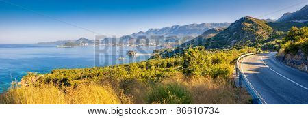 Fantastic view of the Sveti Stefan, small islet and resort in Montenegro. Clear morning scene. White fluffy clouds. Balkans, Adriatic sea, Europe. Beauty world.