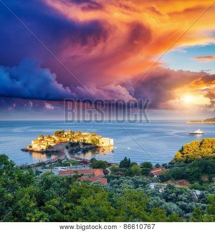 Fantastic view of the Sveti Stefan, small islet and resort in Montenegro. Dramatic morning scene. Overcast sky. Balkans, Adriatic sea, Europe. Beauty world.