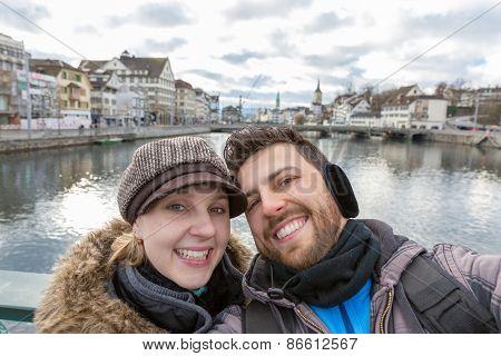 Beautiful Couple taking a selfie photo in Zurich, Switzerland