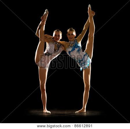 Young girls engaged art gymnastic isolated