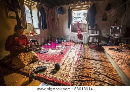 BHAKTAPUR, NEPAL - CIRCA DEC, 2013: Unidentified poor people in his house. The caste system is still intact today but the rules are not as rigid as they were in the past.