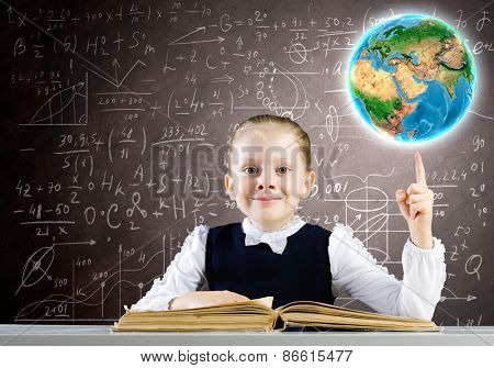 Schoolgirl looking in opened book with sketches at background. Elements of this image are furnished by NASA
