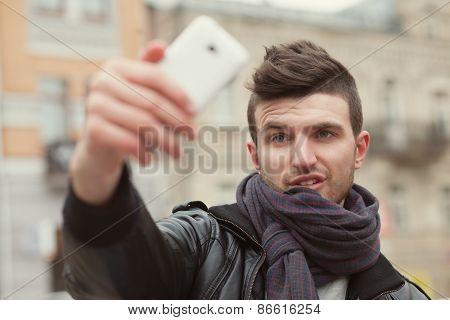 Trendy Guy Taking A Selfie On The Street