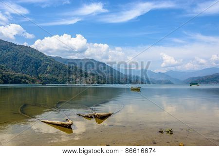 Three sunk boats in Phewa lake, Pokhara, Nepal