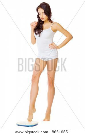 Young healthy girl with home scales isolated