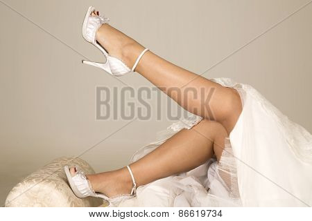 Woman Legs In Wedding Dress Lay Toe Pointed
