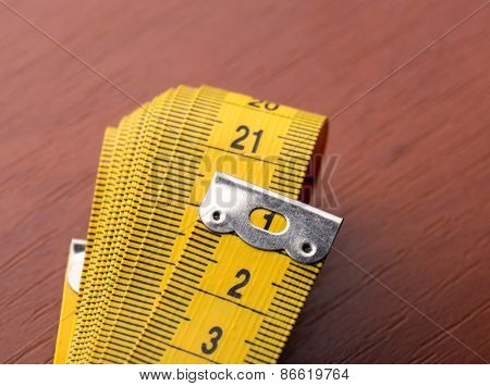 Macro of measurement tape on the wooden table