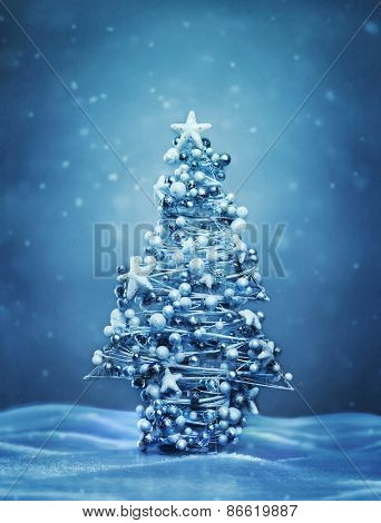Decorated christmas tree at winter evening