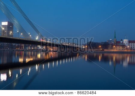 Night view of Riga bridge with reflection in river