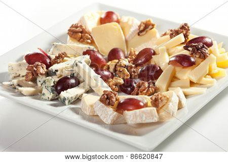Assorted Cheeses with Grapes and Nuts on Platter