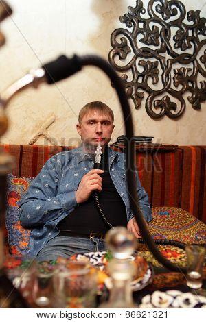Man Smoking Nargile