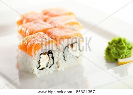 Roll with Cream Cheese and Salmon Roe inside. Salmon topped