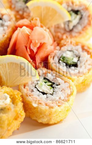 Salmon Fried Maki Sushi - Hot Roll with Cream Cheese and Cucumber inside. Deep Fried Salmon outside.
