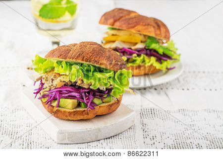 Burger with avocado, white meat grilled chicken, red cabbage, lisityami fresh green salad