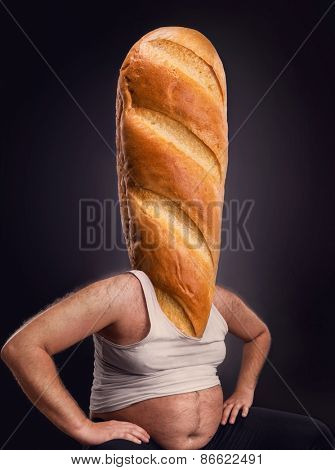 Man with a bread instead of the head over dark background