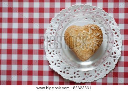 Heart shaped cookie with salt in glass