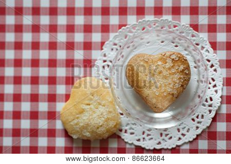 Heart shaped cookies with salt in glass