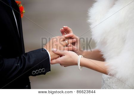 Bride Put The Wedding Ring On Groom