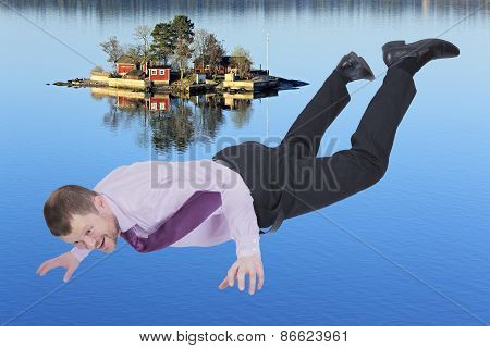 Businessman falling down and sea island in background